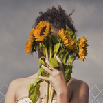 Istock_girl_flowers_front_of_face