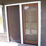 Double Roll-Away Retractable Screen Door - in use