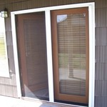 Double Roll-Away Retractable Screen Door - in use