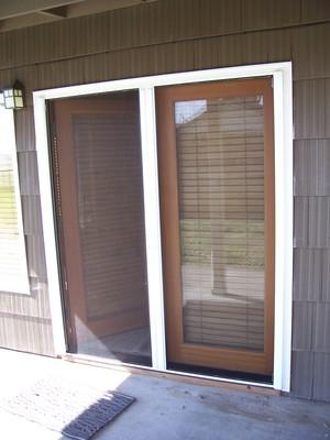 Double Roll Away Retractable Screen Door   In Use