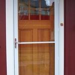Self Storing Storm Door