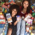 Santana & Newell Roberts sorting food from their drive at school