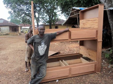 K-wo the carpenter posing with his work