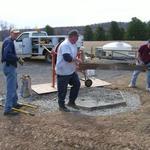 Tony and Doug helping park staff pour concrete pad