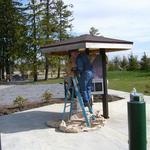 Bob E. painting the kiosk