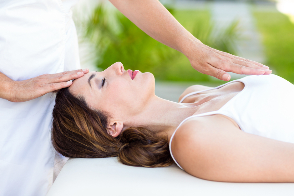 Reiki session with woman at spa