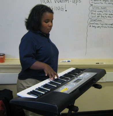 Tyla by the keys.jpg