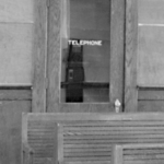 Coin telephone booth in Ft Madison Santa Fe depot 1946