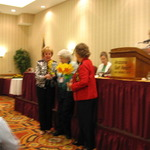 Mary_cochran_and_sandra_ford_present_irene_jensen_with_the_daffodil_photo_award