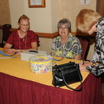 Pearl_nancarrow_and_mary_salcido_sell_a__50-50_raffle_ticket_to_suzanne_thompson