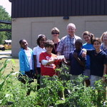 Gardeners receiving the $500 from Yummy Yards Tour