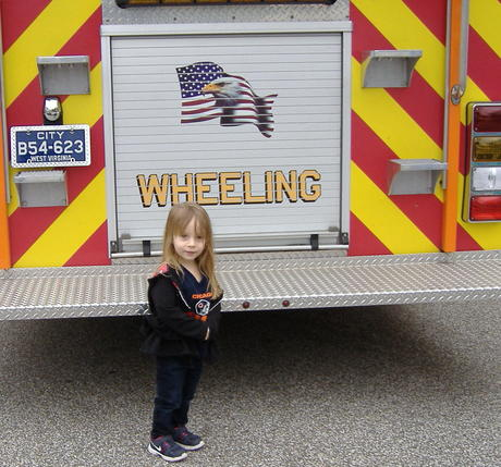 Girl_at_back_of_firetruck.jpg