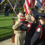 Dana Paton playing Taps at ceremony for veteran's day
