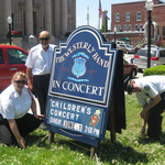 setting up sign for children's concert