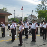 Mystic , CT pause in parade at Train station
