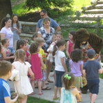 Mama Bear greeting children in readiness -