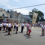 Procession on corner of Tower and Oak Streets