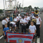 Thorp brothers carrying banner,  Stonington Harbor