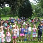 children's concert~~Alison teaching children how to conduct