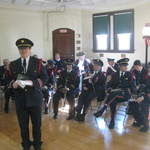 Alison conducting for service in Westerly Armory