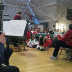 Children gather to sing and welcome Santa