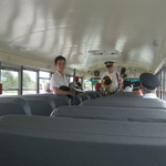 Loading on bus to parade--Rodrie and Pat and Leslie