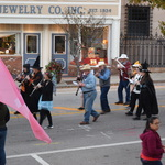 Leading parade backwards up High Street