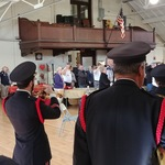 Taps (Chris) at ceremony at Westerly Armory after parade