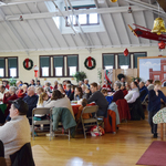 Audience enjoying Christmas concert along with cookies and punch