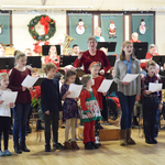 Alison conducts audience for Carol sing a long