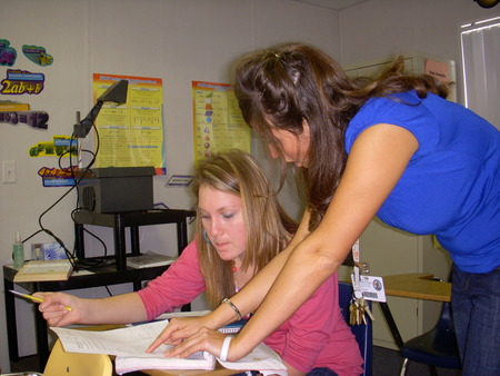 Ms. Wippel helping a Geometry Honors student.