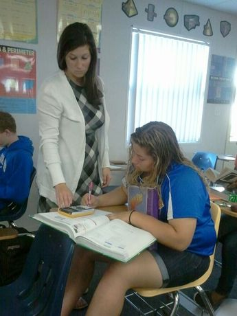 Ms. Wippel showing how to use the graphing calculator.