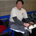 Mr. Ishihara lacing up his skates.