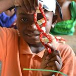 A student is showing off his DNA strand