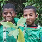 Two students pose with the tree they are about to plant!
