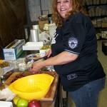 Volunteer Renee working in the kitchen