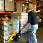 Warehouse Manager, Jim, Operating New Pallet Jack.
