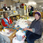 Laura Gibney and Dorothy Mitchell folding bags