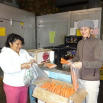 Marbella Baez and Allison Cebula bagging carrots