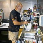 Volunteer Ron washing dishes