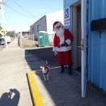 Santa and Helper Arrive at the Food Bank