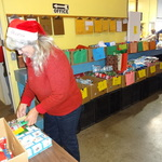 Elf Glendie Assists Santa Claus