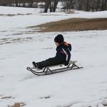 Snow finally this year, the hill was a big hit with the sledders