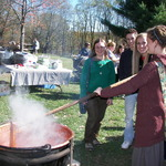 Everyone Getting in on the Apple Butter Stirring