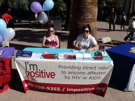 Volunteers Victoria H. and Annette G. PASS THE POSITIVE by answering questions about I'm Positive, Inc.'s programs, services and how to volunteer!