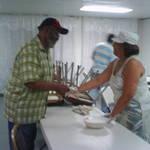 Pastor Greets Volunteer