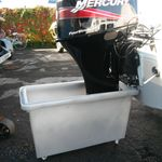 Outboard motor test tank and trolley,
