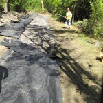 Laying geofabric
