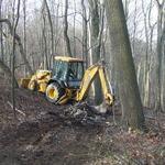 Clayton Fox using heavy equipment to load stone.