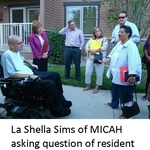 La_shella_sims_of_micah_asking_question_of_resident